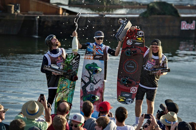 (L-R) Ben Leclair of Canada, Daniel Grant of Thailand and James Windsor of Australia celebrate at the Red Bull Wake of Steel in Linz, Austria on May 21, 2016
